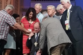 Laying on of hands during a church service