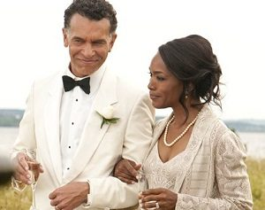 Wealthy African american couple with champagne