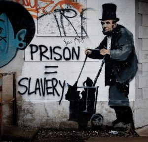 an illustration of Lincoln with the words prison=slavery