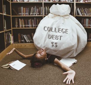 young woman who has fallen on the floor from the weight of college debt