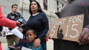 Cheri Honkala, national coordinator for the Poor People's Economic Human Rights Campaign, speaks with reporters outside City Hall about the city's refusal to allow the group to march on the opening day of the Democratic National Convention. (Emma Lee/WHYY)