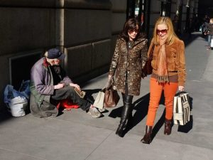 women-high-income-walking-past-homeless-man-street