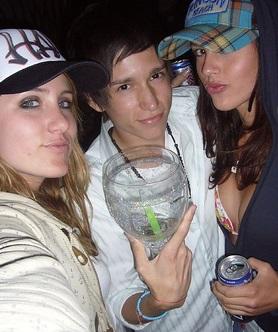 slightly drunken students holding drinks