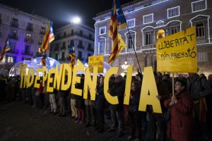 protesters in the Catalan region of Spain holding letters spelling out independence
