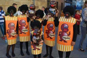 people dressed in blackface like the ubiquitous Spanish candy Conguitos