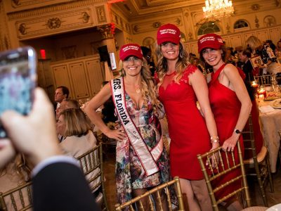 Ms. Florida poses with female members of President Trump's Mar a Lago estate, wearing MAGA hats.