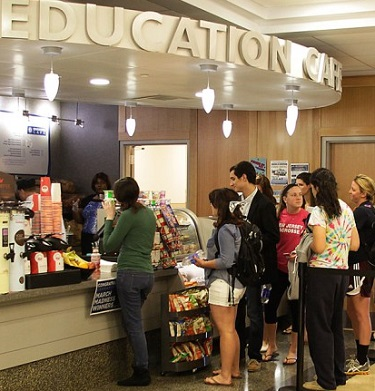 College students waiting in line for food at the cafe.