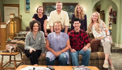 Roseanne show family on the famous couch circa 2008