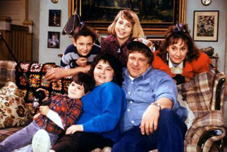 The original cast of the series Roseanne (circa 1988) on their famous couch