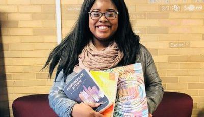 Johnasia McCrea with textbooks