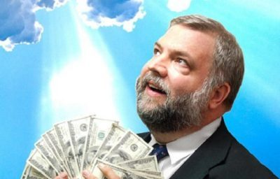 man holding cash and looking to the divine sky with a sly smile