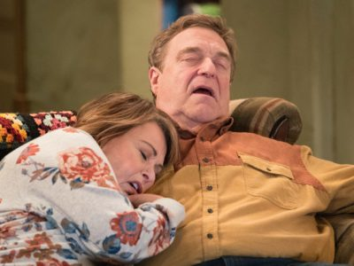 Roseanne Barr asleep on the couch with TV spouse
